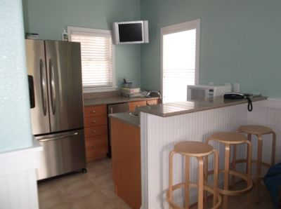 First Floor wet bar with full size fridge and stand alone ice maker.