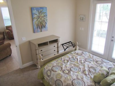 1st Floor Bedroom With French Doors To Patio, Gas Grill, Water Feature, And