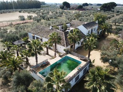 Photo for Typical Andalusian charming hacienda in the heart of a 9 acre garden