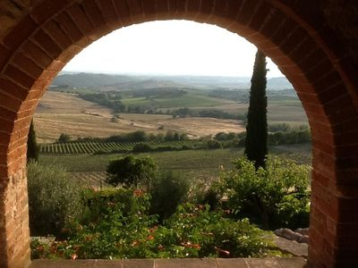 Photo for A view of San Gimignano from  the top of a hill covered with vineyards