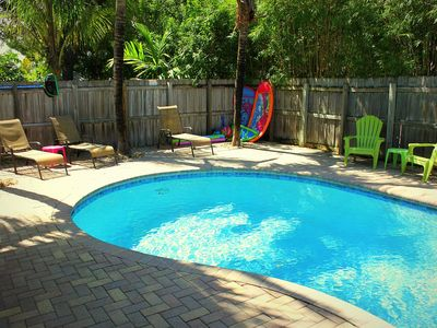 Large Private Pool Area With Lounge Chairs, Gas Grill, And Dining Area.