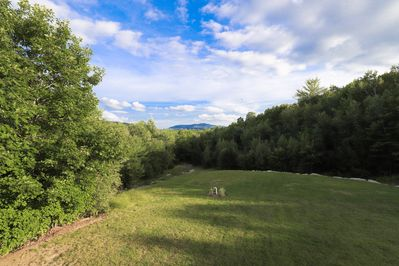 Rear view of backyard, conservation land and Mount Sunapee