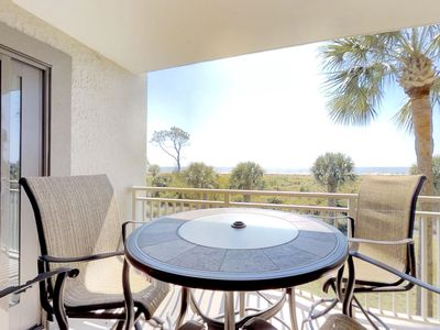 Photo for Bright oceanfront condo with a shared pool and hot tub! Near the beach!