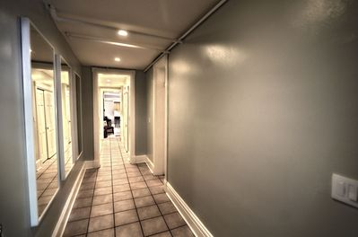 Entry way leading to master bedroom and living area.