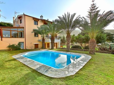 Photo for This 5-bedroom villa for up to 10 guests is located in Karteros and has a private swimming pool, air