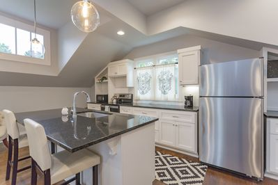 Gorgeous  fully stocked kitchen with black granite counter tops