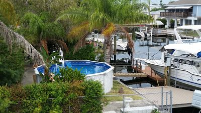 Photo for Waterfront Pool Home 5 min from beach, kayaks, bikes, fish from dock!