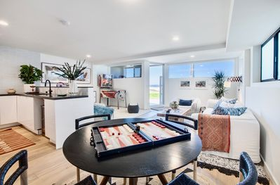 Dining, Living + Kitchen. Clean and modern living at the beach.