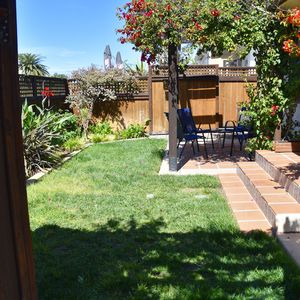 Front yard with shaded sitting area