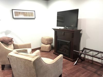 Room includes a flat screen TV and a separate sitting area.