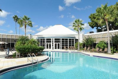 Large heated swimming pool, hot tub and poolside loungers