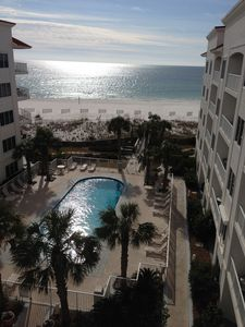 View of pool courtyard and Gulf of Mexico from the unit balcony.