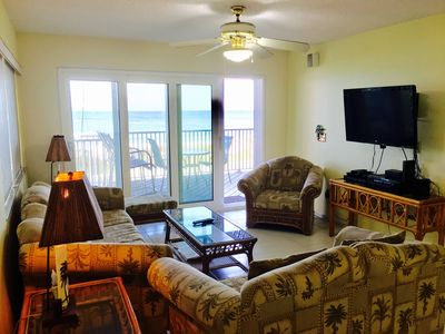 sitting area with private balcony overlooking the Gulf of Mexico and Beach !