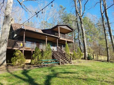 spacious log cabin on 3+ acres with river access on property