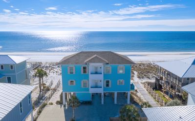 Photo for Tastefully decorated. In deck Gulf front pool with private walk-over to beach