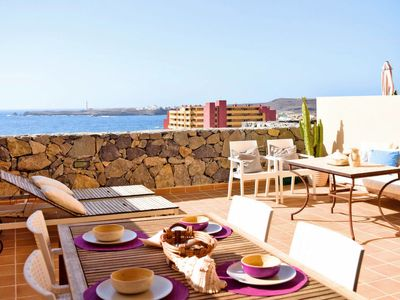 Photo for 3 bedroom Apartment, sleeps 5 with Pool and Walk to Beach & Shops