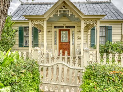 Photo for Victorian home w/ a porch & lawn, in the historic district!
