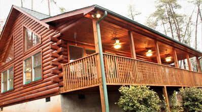 beautiful log cabin with 40 foot porches in front and back