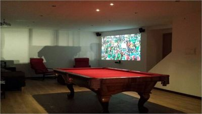 Games room with pool table and home cinema