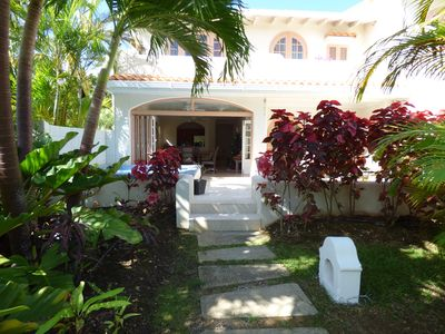 Rear of the house set within lush ground of Sugar Hill resort