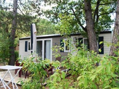 Photo for Camping La Pinède **** - Bungalow Trigano 3 rooms 4 people