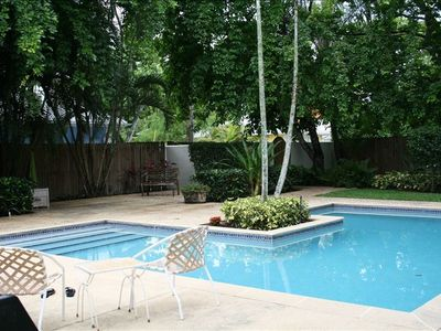 Private rear yard with deep, large heated pool / walk to beach