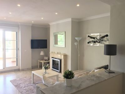 Comfortable living room with multi station TV / Apple TV and Netflix