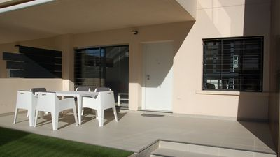 Photo for Modern apartment at 200 m from the sea with a south facing terrace and swimming pool