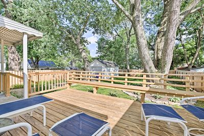 This house boasts a beautiful backyard with a sun-drenched deck.