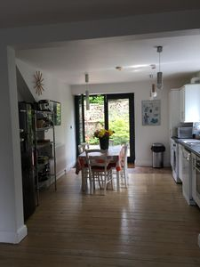 View of kitchen with patio doors leading to terrace area.