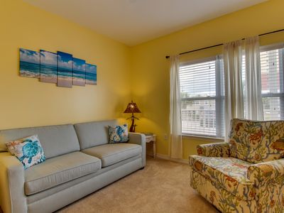 Photo for Well-equipped condo with shared pool across the street from the beach