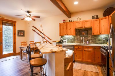 Newly updated kitchen features granite counters & backsplash & new appliances.
