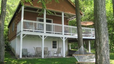 Covered porch, open deck, lower level patio and hammock facing Lake.
