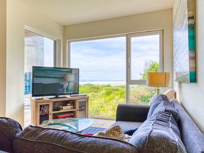 Photo for Oceanfront dog-friendly condo w/close beach access, shared hot tub, great decor!