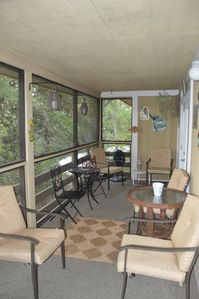 Spacious porch with plenty of seating. Try our hook and ring game