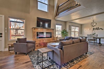 Spend time gathered in the cozy living room complete with electric fireplace!
