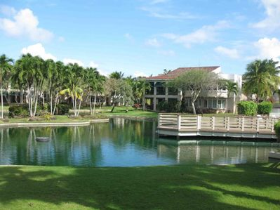 View from your patio to the lake and pool and clubhouse