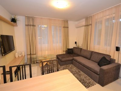 Photo for Luxury apartment on ground floor with spa and swimmingpool, beach 120m,free WIFI