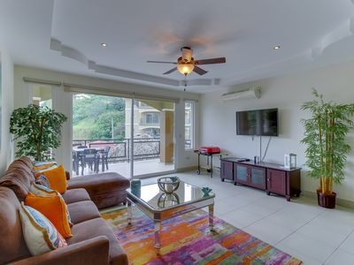 Photo for Enchanting condo with shared pools in quiet location
