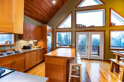 Stoke Cabin - Open Planned Kitchen and Dining Room with Walk Out to Balcony