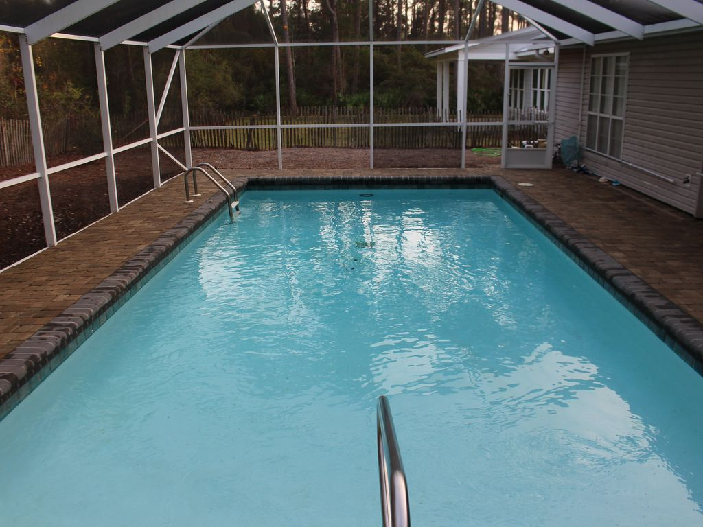 Private swimming pool fenced yard seacrest florida for Private swimming pool