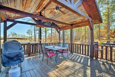 With a furnished deck, hot tub, and beds for 9, this cabin is truly 5-star.