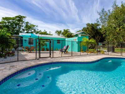 Photo for Mango Villa  - Steps away from beach / private heated pool