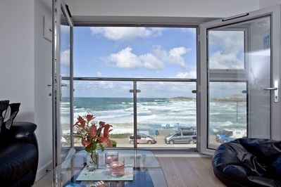 Floor to ceiling windows with views out to sea