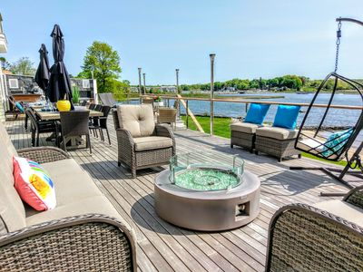 Deck with ample, various seating options for guests with amazing water views