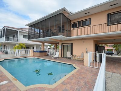 Photo for The Perfect Getaway with Heated Swimming Pool, Jacuzzi and Boat Slip