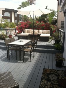 'Hang out' deck w/view.  Couch, dining table for 4, bar table for 4, 2 umbrellas