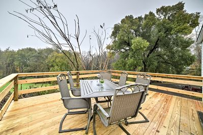 The vacation rental home boasts lush views and a brand new deck!