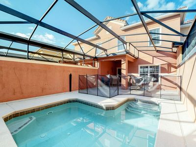 Photo for Spacious townhouse in a gated resort w/ shared pools, a Tiki bar, gym, & tennis