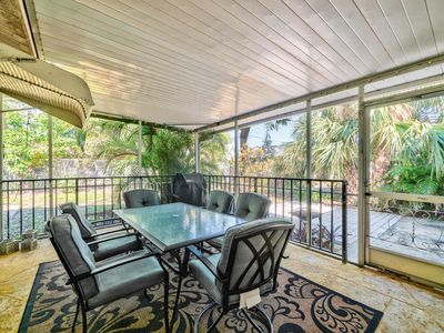 Covered Porch - The covered porch has a propane grill and glass-top table that seats 6.